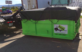 your dumpster rental is tarped before it hits the road